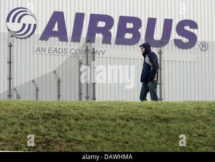 (dpa file) A man walks past the Airbus plant Nordenham, Germany, 06 February 2006. Photo: Ingo Wagner - Stock Image