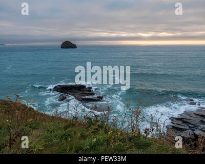Looking out to the sun setting over the sea on the north Cornwall coast - Stock Image