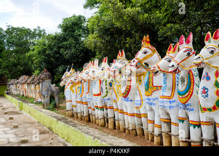 Painted terracotta horse statues at a village temple dedicated to Ayyanar god, Tamil Nadu, India. - Stock Image