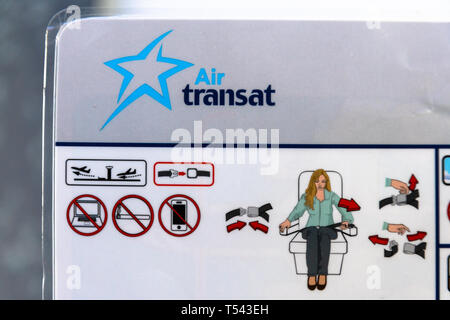 Air Transat safety card found on a Boeing 737-700. It is law in Canada for the crew to go over the instruction card with the passengers before take of - Stock Image