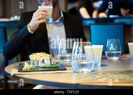 Close-up of food and drinks served on table - Stock Image