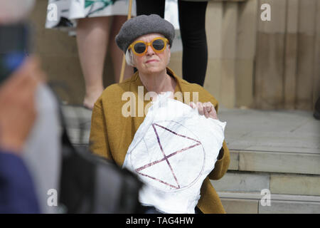 An Activist from the Climate Change group Extinction Rebellion holds a piece of paper with the Extinction Rebellion logo written on it during a demo outside Derby City Council house on 22/05/2019 - Stock Image