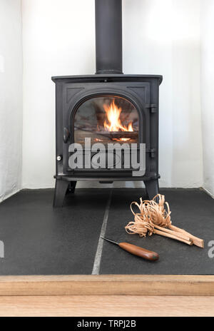 Wood Burning/Multi-Fuel Stove with Feather Sticks as Kindling for Fire Lighting, UK - Stock Image