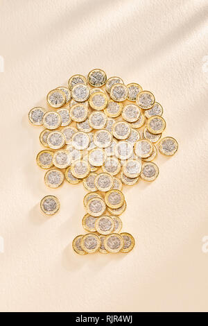 Collection of £ One Pound Coins in the Shape of a Tree - Stock Image