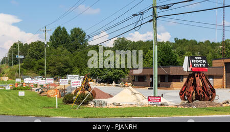 HICKORY, NC, USA-9/2/18: A landscape supplier selling stone, and a 'See Rock City' sign. - Stock Image