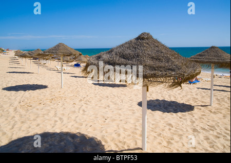 Faro Beach, Umbrellas, Algarve, Portugal - Stock Image