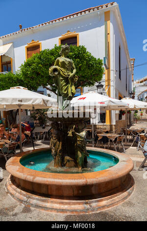 Estepona, Malaga, Spain: A colourful street scene - a water fountain - Stock Image