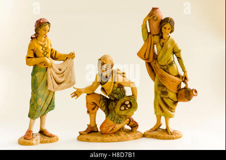 Three Neapolitan figurines portraying historic trades seen around Naples in Italy and offered for sale at Christmas - Stock Image