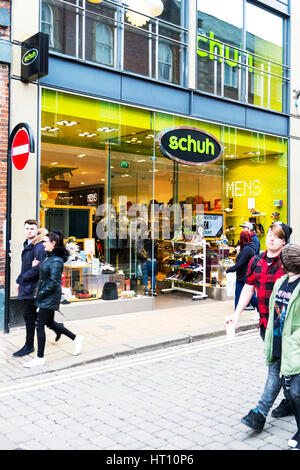 Schuh shoe shop store front name sign signs schuh shoes UK England - Stock Image