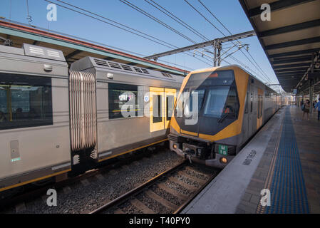 An M Set Millennium train enters Central Station in Sydney from the south beside a stationary Waratah A train - Stock Image