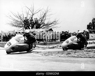 Apr 25, 1955; Berlin, Germany; Starting of the moto-racing season on the Dieburg course HANS BALTISBERGER in first No 121 and H.P. MULLER in second place. - Stock Image
