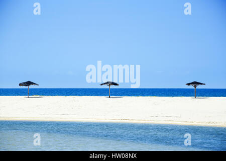 Tropical landscape sea umbrella resort beach - Stock Image