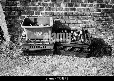 Crates of glass bottles out for recycling collection, Hattingley, Medstead, Alton, Hampshire, England, United Kingdom. - Stock Image