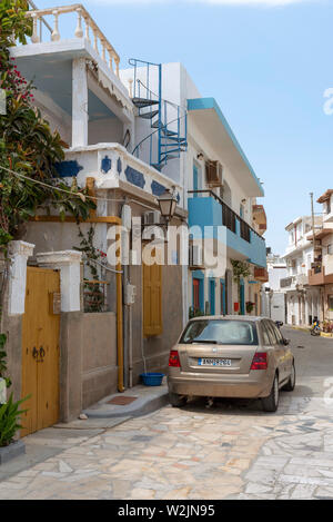 Crete, Greece. June 2019. A narrow street and car in the old town area of Ierapetra, southern Cret. - Stock Image