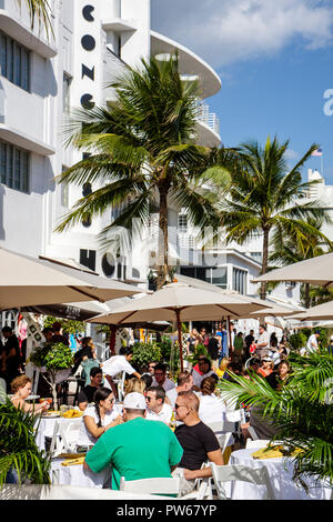 Miami Beach Florida Ocean Drive New Year's Day Art Deco District Congress Hotel restaurant alfresco al fresco dining umbrellas - Stock Image