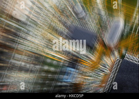 computers circuitboard with large microchip, slight zoom effect - Stock Image