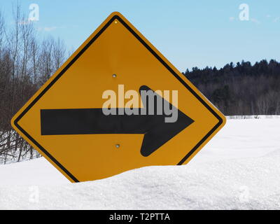 Quebec,Canada. Sharp right turn in road warning sign. - Stock Image