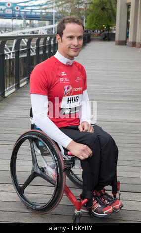 London, UK. 25th Apr 2019. Marcel Hug(CH) attends The London Marathon Wheelchair Athletes Photocall which took place outside the Tower Hotel with Tower Bridge in the background ahead of the Marathon on Sunday.Credit: Keith Larby/Alamy Live News - Stock Image