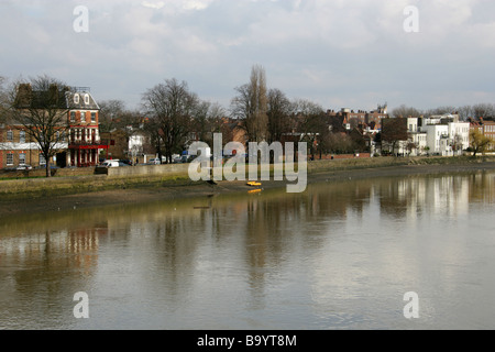View of the North Bank of the River Thames from Kew Bridge, Looking East, Kew, Richmond, Surrey, UK - Stock Image