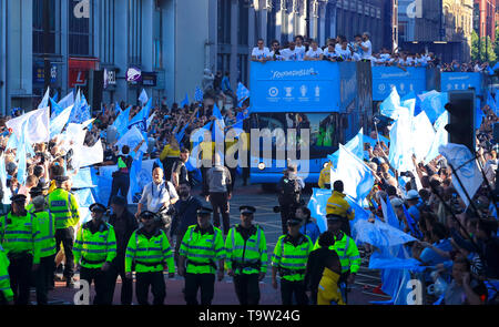 Manchester City players and staff on the bus during the trophy parade in Manchester. - Stock Image