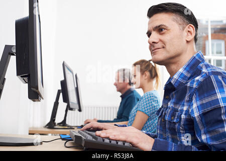 Mature Man Attending Computer Class In Front Of Screen - Stock Image