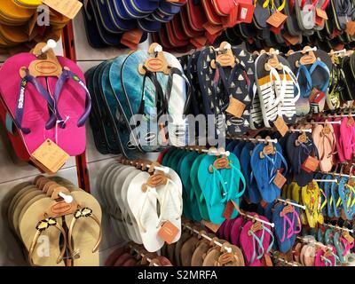 Flip flops in a shoe shop - Stock Image