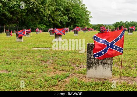 American Civil War Confederate army cemetery with small confederate flags by the headstones in Marbury Alabama, USA. - Stock Image