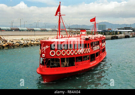 Sponsored red Star Ferry by Virgin Atlantic, Hong Kong Harbour - Stock Image