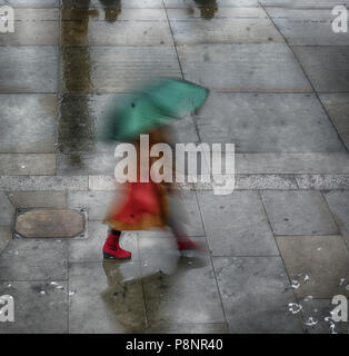walking in rain umberlla wet - Stock Image