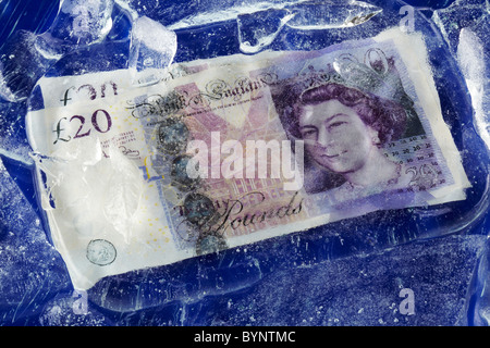 Twenty Pound Notes Frozen on Ice - Stock Image
