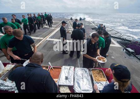 PHILIPPINE SEA (Feb. 19, 2016) The chief's mess serves barbecue to the crew during a steel-beach picnic aboard - Stock Image