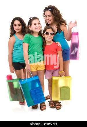 four young girls with shopping bags isolated on white. - Stock Image