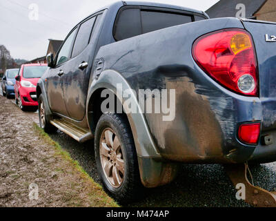 Cars damaged by the scrum during Ashbourne Royal Shrovetide hugball Football match Ash Wednesday 14th February 2018. - Stock Image