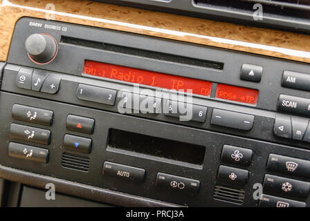 Dusty radio in a 2007 BMW 318i. - Stock Image
