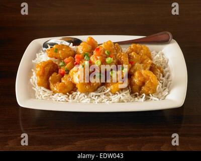 Crispy shrimp with white rice - Stock Image