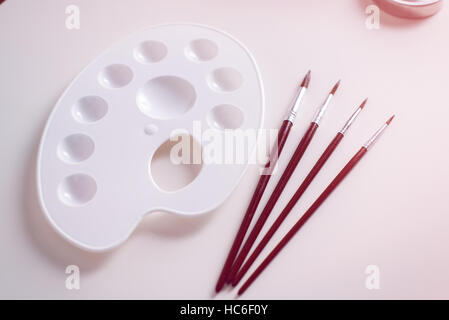Paint brushes and plastic palette - Stock Image