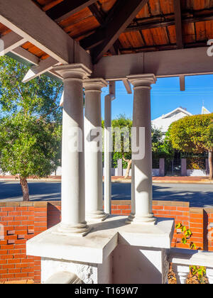 Three white columns on a verandah feature of a residential house in Perth WA Australia. - Stock Image