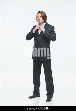 The handsome men in black suits differently pose on a white background, serious - Stock Image
