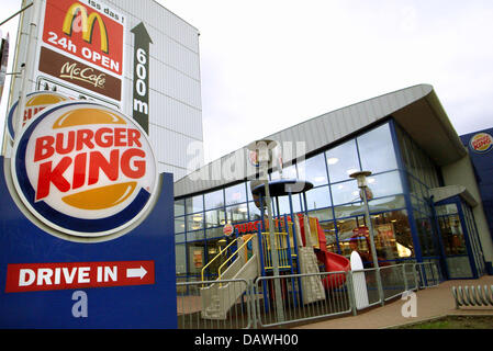 The logos of leading fast food chains Burger King (bottom L) and McDonald's (top L) pictured in Hamburg, Germany, - Stock Image