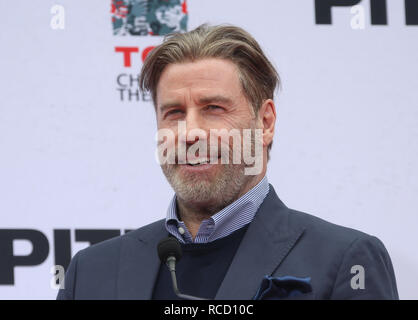 Pitbull is honoured with a hand and footprint ceremony at the TCL Chinese Theatre  Featuring: John Travolta Where: Hollywood, California, United States When: 14 Dec 2018 Credit: FayesVision/WENN.com - Stock Image