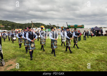 Stirling, Scotland, UK. 5th August 2018. Strathallan Games Park near Stirling is the venue for the 167th Bridge of Allan Highland Games.  Members of the Royal Burgh of Stirling Pipe Band play traditional Scottish bagpipes and drums as they march across the showground. In competions like today they wear their number 2 uniform with the Stirling and Bannockburn Caledonian Society tartan. Credit Joseph Clemson, JY News Images/Alamy Live News. - Stock Image