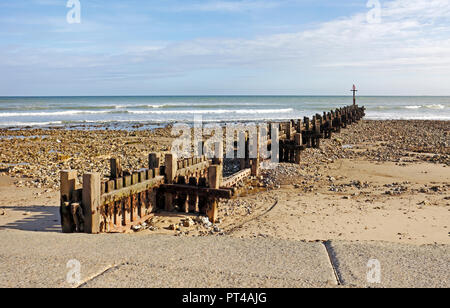 Beach with large timber breakwater in North Norfolk at West Runton, Norfolk, England, United Kingdom, Europe. - Stock Image