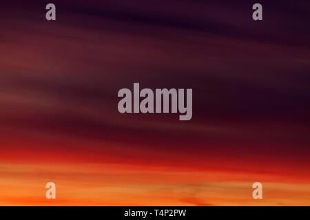 Glowing red evening sky at sunset, Baden-Wurttemberg, Germany - Stock Image