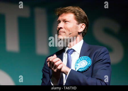 Richard Tice, Chairman of The Brexit Party, introducing the speakers, during a Political Rally held at Olympia London - Stock Image