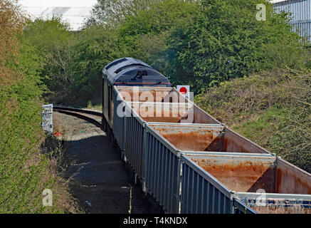 A GBRF, diesel locomotive starts its train of empty stone wagons up the branch line from the Hanson aggregate depot at Ashton in Makerfield. Cw 6690. - Stock Image