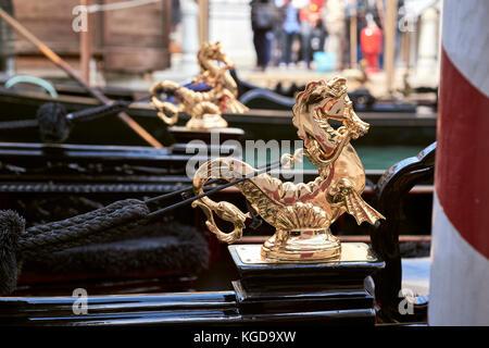 Detail of a gondola design featuring golden seahorses - Stock Image