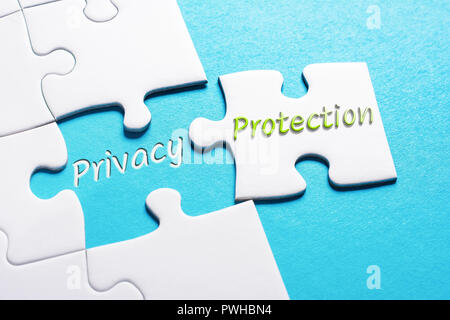 The Words Privacy And Protection In Missing Piece Jigsaw Puzzle - Stock Image