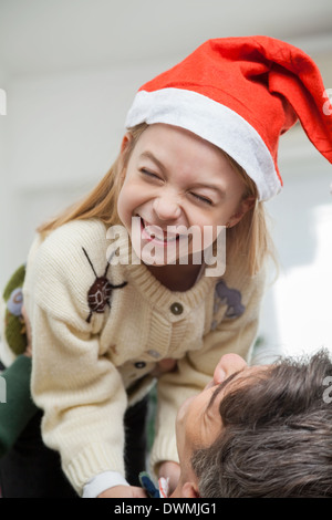 Cheerful Girl Being Carried By Father - Stock Image