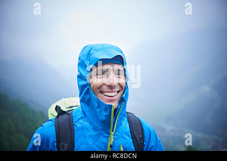 Portrait of hiker in wet conditions, Mont Cervin, Matterhorn, Valais, Switzerland - Stock Image
