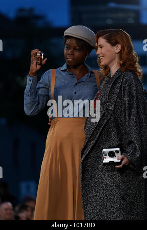 Quebec,Canada. A couple of female models pose for a selfie on the catwalk. - Stock Image
